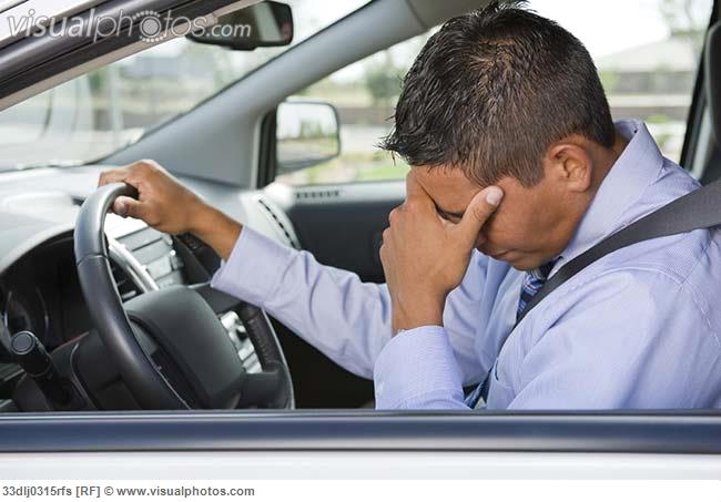 Frustrated_businessman_driving_car_33dlj0315rfs
